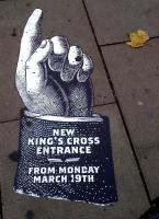 Just remind me, which century are we in? This Victorian-style sign on the pavement directs passengers to the new King's Cross passenger entrance. It is standing up to footfall rather well - it must have been there for about eight months.<br><br>[Ken Strachan&nbsp;09/11/2012]