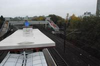 This view looks towards the footbridge and lifts under construction at the west (or north) end of Hyndland station. In the foreground is the top of a relatively recently added open air shelter. A new platform will be built to the right.<br><br>[Ewan Crawford&nbsp;14/11/2012]