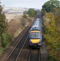 The 12.07 First Scotrail Class 170 Aberdeen - Edinburgh approaches Fordoun on 20 October 2012. Photographed from the road bridge alongside the station site [see image 40838] looking north east towards the Network Rail track access point in the middle distance. <br><br>[John McIntyre&nbsp;20/10/2012]