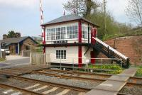 A sunny May morning at Culgaith in 2006. The Midland signal box stands alongside the B6412 level crossing with part of the former station (closed May 1970) in the background and Culgaith Tunnel off picture to the left.<br><br>[John Furnevel&nbsp;06/05/2006]
