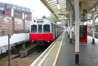 View from the station concourse over the platform 7 buffer stops at Richmond on 22 July 2005, with a District Line train for Upminster awaiting its departure time.<br><br>[John Furnevel&nbsp;22/07/2005]