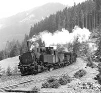 Giesl ejector fitted 0-6-2RT No. 97.208 eases the 09.39 empties from Vordernberg downhill at Feistawiese on 14 April 1976, with sister locomotive No. 97.201 providing additional braking assistance at the rear of the train.<br><br>[Bill Jamieson&nbsp;14/04/1976]