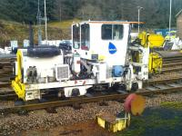 Track machine in the PW sidings alongside Crianlarich station on 23 November 2012. <br><br>[Brian Smith&nbsp;23/11/2012]