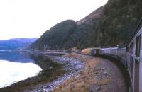 The railway deviation caused by the landslip-prone new A890 road is just apparent ahead of this train east of Strome Ferry in Summer 1974.<br><br>[David Spaven&nbsp;//1974]