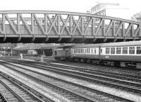 A class 50 about to enter Paddington station with a South Wales train in 1979. In the background a class 31 stands alongside the platform of Paddington parcels depot with vans being loaded beyond. [See image 42682]<br><br>[John Furnevel&nbsp;14/09/1979]