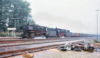 DB 043 121 + 043 903 take a lengthy freight through Leschede on 25 June 1977.<br><br>[Peter Todd&nbsp;25/06/1977]