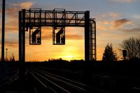The east end signal gantry at Didcot in the early morning sun on 4 December 2012.<br><br>[Peter Todd 04/12/2012]