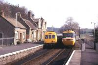 An HST en route to Barnstaple passes a local DMU at Eggesford on 18 March 1990.<br><br>[Ian Dinmore&nbsp;18/03/1990]