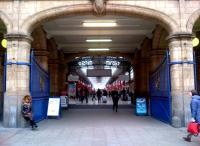 The grand entrance to Marylebone Station in November 2012. The lady on the left appears to be happy taking up 50% of the available seating - though it doesn't look very comfortable to me.<br><br>[Ken Strachan&nbsp;09/11/2012]