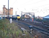 The East Coast 13.30 Edinburgh - Kings Cross runs over the much simplified Newcastle East Junction on its way into Central Station. The old Coast/Wearside bay platforms are now part of the car park. [See image 1616] for the same location 30 years earlier, prior to the changes to track and pointwork made possible by the reduction in conflicting movements. <br><br>[Malcolm Chattwood&nbsp;01/12/2012]