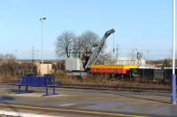 It would appear that the Didcot Railway Centre have taken to using their mobile crane as shed shunter! View from the platform at Didcot station on 4 December. <br><br>[Peter Todd 04/12/2012]