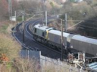 GBRf 66739, formerly Freightliner 66579, heads a long train of coal hoppers north at Deeerness Valley Junction, just south of Durham station. This picture was taken from a viewpoint that has been created on the pier of the old stone bridge that spanned the tracks at this point but was demolished after replacement by a steel one. Even a bench is provided!<br><br>[Mark Bartlett&nbsp;27/11/2012]