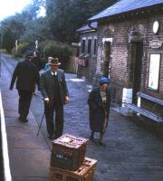 A long forgotten aspect of the railway 'parcels' business - baskets of live homing pigeons on the platform at Lllanwrtyd Wells station on the Central Wales Line in summer 1971. Pigeon fanciers would send the baskets by train, with a 50p coin attached as a tip to rail platform staff for setting the pigeons free!<br><br>[David Spaven&nbsp;//1971]