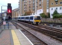 Residential developments on the approaches to Marylebone seem much more modern and 'greener' than at certain other London termini. It hardly feels like you're in 'The Smoke' at all! A Clubman drifts into the former Great Central terminus on 9th November. [see image 41096]<br><br>[Ken Strachan&nbsp;09/11/2012]