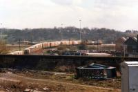 A view no longer possible from Wakefield Kirkgate station as an unidentified Railfreight liveried class 47 shunts a part rake of Greater Manchester Waste containers in the Witham Sidings. This was in March 1988, during the period when waste was being taken to the Welbeck landfill site near Normanton. <br><br>[David Pesterfield&nbsp;29/03/1988]