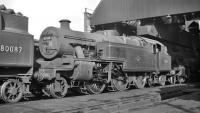 Shed scene at Bangor (6H), thought to have been photographed in 1959, featuring 2-6-4 tanks. Stanier no 42567 is stabled behind BR Standard example no 80087.<br><br>[K A Gray&nbsp;//1959]