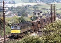 The use of a loco of only 1250 HP on the Tunstead to Winnington limestone trains might seem rather surprising, nonetheless the BR Type 2s still managed a twenty year sojourn on these duties. D7659 passes Chinley North Junction with returning empties on the sunny morning of July 17th 1972.<br><br>[Bill Jamieson&nbsp;17/07/1972]