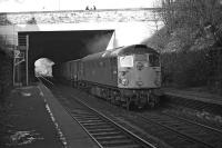 A short fitted freight hauled by BRCW Type 2 No. D5310 emerges from under the Union Canal and Colinton Road in March 1970 to pass between the disused platforms of Craiglockhart station. The train is thought to be the early running 13.15 Perth to Millerhill. <br><br>[Bill Jamieson&nbsp;13/03/1970]