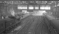 Looking south through Carlisle station from the footbridge on 1 July 1961. On the left D34 4-4-0 no 62484 <I>Glen Lyon</I> has recently arrived with the 12.25pm stopping train from Hawick.<br><br>[K A Gray&nbsp;01/07/1961]