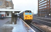 50036 <I>'Victorious'</I> with a train at a wet Swindon station in July 1980.<br><br>[Peter Todd&nbsp;06/07/1980]