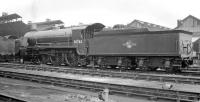 Part of the shed yard at Nine Elms, thought to have been photographed in late 1959. The featured locomotive is 'King Arthur' class 4-6-0 no 30763 <I>Sir Bors de Ganis</I>, withdrawn from here in September 1960. <br><br>[K A Gray&nbsp;//]