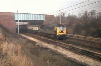 In weak winter sunshine 47448, with a Blackpool North to Manchester Victoria <I>Club Train,</I> slows for the crossovers at Euxton Junction in 1980. The train is passing under the M6 and will cross from the WCML Up Slow to take the Chorley and Bolton line. 47448, the former D1565, lasted in service until January 1991 when it was withdrawn from Crewe. It was cut up at Booths, Rotherham in 1996. <br><br>[Mark Bartlett&nbsp;10/01/1980]