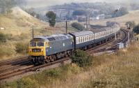 Passing the west end of the Grantshouse loops, Brush Type 4 No. 1534 has just over 40 miles to go before reaching journey's end with the 10.45 Kings Cross to Edinburgh service in August 1971.<br><br>[Bill Jamieson&nbsp;19/08/1971]