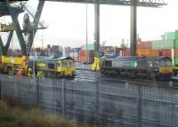 Freightliner locomotives 66534 and 66418 (the latter still in former operator DRS livery) under a large container straddle crane at Birmingham Lawley Street Freightliner Terminal on the morning of 3 December 2012.<br><br>[David Pesterfield&nbsp;03/12/2012]