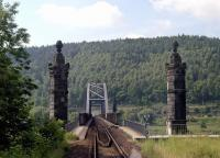The view ahead from the 08.30 Neustadt (Sachsen) to Bad Schandau train which is about to step onto the bridge over the River Elbe shortly before reaching its destination in June 2001. The Prague to Dresden main line can be discerned just below the trees on the far side.<br><br>[Bill Jamieson&nbsp;26/06/2001]