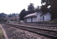 Looking across the running lines towards the old station at Limpley Stoke, on the Bath - Westbury route, in October 1996, approximately 30 years after closure. View is south west, with the River Avon behind the camera. [See image 38385]<br><br>[Ian Dinmore&nbsp;/10/1966]