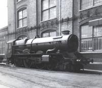 A tenderless 'King' Class 4-6-0 no 6018 <I>King Henry VI</I> stands outside Swindon Works in June 1963 awaiting attention.<br><br>[David Pesterfield&nbsp;09/06/1963]