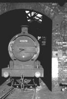 J27 0-6-0 no 65870 stands in the arched entrance to the roundhouse at Sunderland South Dock, thought to be in the autumn of 1962.<br><br>[K A Gray&nbsp;//1962]