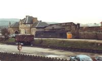 Derby built Type 2 Bo-Bo Diesel 25144 stabled alongside a lone 16T coal wagon in the former coal sidings running along the Broughton Road side of Skipton station in 1980.<br><br>[David Pesterfield&nbsp;18/01/1980]