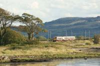 334036 skirts the Clyde at Ardmore as it heads east towards Glasgow on 22 September 2012. Although the photo features the north bank of the river in the foreground, the hills in the background are on the south shore above Langbank.<br><br>[John McIntyre&nbsp;22/09/2012]