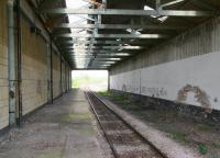 The overall roof over a section of the through platform at North Road, Darlington in April 2009 looking west towards Bishop Auckland. Trains no longer stop under the roof but use the eastern end of the platform nearest the McNay Street entrance. It does however appear to be much appreciated by the local pigeons. [See image 30877]<br><br>[John Furnevel&nbsp;24/04/2009]