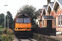 EWS 60001 waits by the former Coxbench station, Derbyshire (closed June 1930) for the crossing gates to be opened before heading up the Denby freight branch to the opencast loading point in July 1997. The mothballed branch was finally lifted during 2012.<br><br>[David Pesterfield&nbsp;15/07/1997]