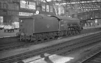 An undated photograph showing Gresley A3 Pacific no 60079 <I>Bayardo</I> posing alongside platform 4 at Carlisle station. One of the small band of 'Canal Pacifics' used on Waverley route services, no 60079 spent the whole of the period from nationalisation up to withdrawal in September 1961 at Carlisle Canal shed. [See image 19295]<br><br>[K A Gray&nbsp;//]