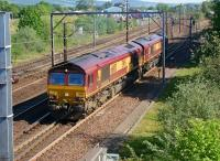 A pair of Class 66s come out of the down loop at Beattock and resume their journey north on 27 May 2012.<br><br>[John McIntyre&nbsp;27/05/2012]