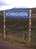 Achnasheen's under-populated hinterland is the backcloth to the rusting station nameboard in summer 1974.<br><br>[David Spaven&nbsp;//1974]