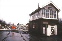 The signal box and level crossing at Saxilby, Lincolnshire, in January 1988. View north west towards Gainsborough with the top of Saxilby station building visible in the background [see image 41173]. <br><br>[Ian Dinmore&nbsp;/01/1988]