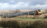 A northbound Voyager catches the sun as it passes through southern Cumbria, close to the former station at Burton and Holme, on 18 February 2012. [See image 22857]<br><br>[John McIntyre&nbsp;18/02/2012]