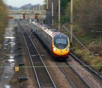 An up 9-car Pendolino climbs towards the summit between Preston and Wigan at Coppull on 23 November 2012. Coppull station was situated approximately a quarter of a mile to the north.<br><br>[John McIntyre&nbsp;23/11/2012]