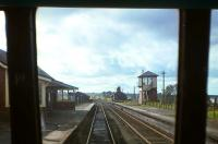 View of Muirkirk station and signal box looking west from the rear of a DMU about to depart for Lanark, just weeks before the 5th October 1964 withdrawal of passenger services. The line ahead to Cronberry and Auchinleck survived for freight traffic for a further 4� years.<br><br>[Frank Spaven Collection (Courtesy David Spaven)&nbsp;05/10/1964]
