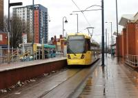Metrolink tram 3014 waits briefly on a wet day at Eccles before returning to Piccadilly via the Salford Docks estate. Eccles tram terminus is only a short walk from the main line railway station. Pity about the litter at this town centre interchange.<br><br>[Mark Bartlett&nbsp;28/12/2012]