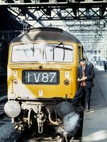The timetable changes in the spring of 1971 included the commencement of through working to the Western Region, specifically the 09.40 Edinburgh - Paignton, which made the 1V reporting number an everyday sight in the Scottish capital. Driver Robinson of Gateshead stands next to the first southbound train, hauled by Brush Type 4 No. 1538 of Immimgham, shortly before departure from Waverley on 3rd May 1971.<br><br>[Bill Jamieson&nbsp;03/05/1971]