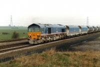 National Power's 59205 approaching Burton Salmon with a coal train from the Selby coalfield Gascoigne Wood loading point to Drax Power Station in March 1997. The front two wagons appear to be recently into service. <br><br>[David Pesterfield 07/03/1997]