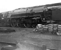 BR Britannia Pacific no 70004 <I>William Shakespeare</I> stabled alongside a stack of firebox arch blocks in Crewe North shed yard in April 1964.<br><br>[David Pesterfield&nbsp;18/04/1964]