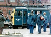 Platform scene at Guide Bridge on 21 April 1981 during a break on the LCGB <I>'Easter Tommy'</I> railtour. The special ran from Liverpool to Lincoln and back, with 76025 taking charge on the outward and return legs between Guide Bridge and Rotherwood Sidings. This was the last class 76 hauled passenger train.<br><br>[Colin Alexander&nbsp;21/04/1981]
