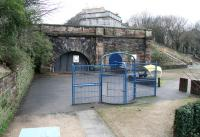 Close up of the north portal of the 1847 Scotland Street Tunnel, seen from the old goods station in January 2013 - now forming part of a basketball court. The west side of Scotland Street itself overlooks the scene with Royal Crescent running off to the right. [See image 5876]<br><br>[John Furnevel&nbsp;08/01/2013]