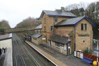 The 1847 station building at Broadbottom is in near original external condition, despite a pub having been incorporated into part of the building. The station, and nearby Broadbottom viaduct, are listed on the Transport Heritage Trust website as being of special interest. There is a half hourly service in each direction on the Manchester - Glossop/Hadfield route. This view is towards Manchester from the station footbridge. <br><br>[Mark Bartlett&nbsp;28/12/2012]